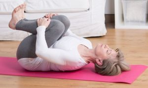 Mature woman practicing pilates